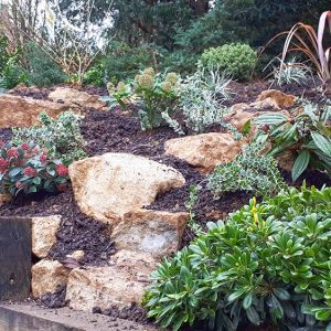 Hillside-planting-with-retaining-sleepers