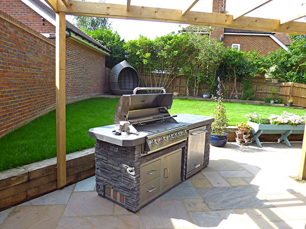new patio with stone-built outdoor kitchen with cooker