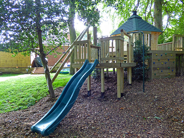 Raised decking play area featuring slide