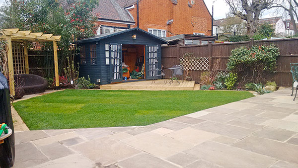 New patio, soft landscaping and refurbished summer house