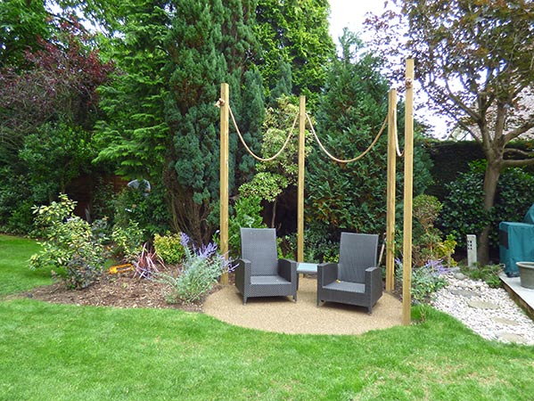Arbour with outdoor seating on bonded gravel base